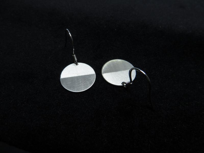 Ohrringe mit Perspektivwechsel